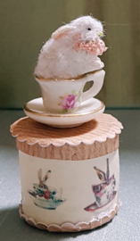Small box with a cute bunny rabbit in the cup, height 6 cm.