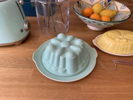 Puddingvorm met schotel groen