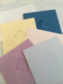 Vijf reliëf kaarten pastel