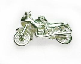 zilveren motorfiets met kuip