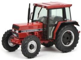CIH 633 tractor met cabine en voorwiel aandrijving Schuco. SC7794 Schaal 1:32