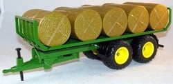 Rolling round bales wagon with straw Si2891 Scale 1:32