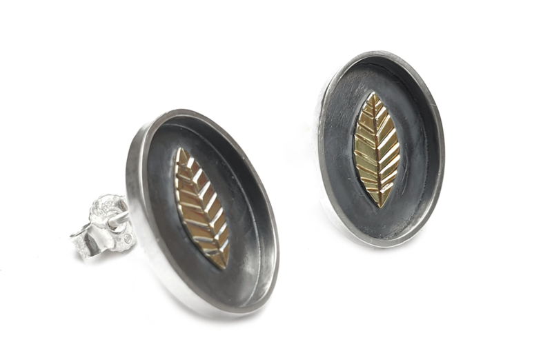 Golden leaves in silver oval earrings