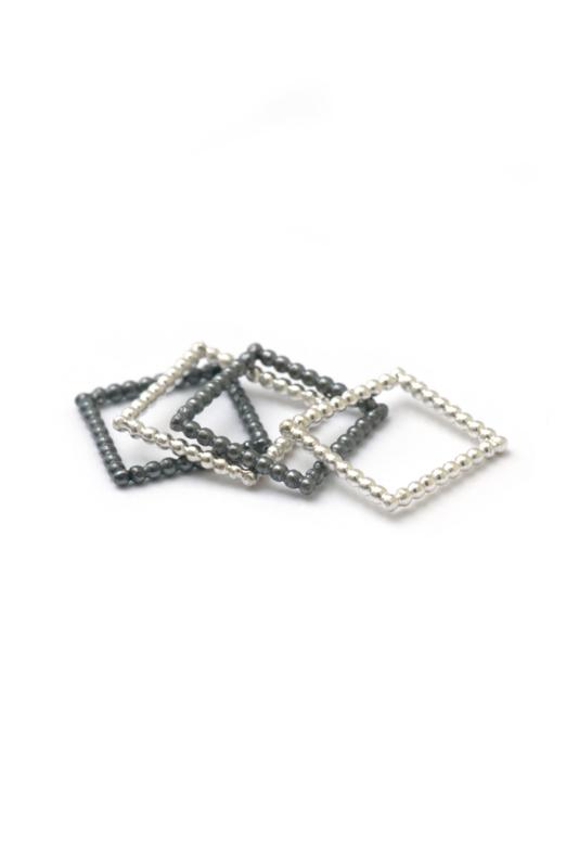 Stapeltje vierkante ringen