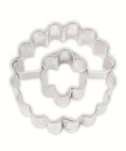 Cirkel gekarteld met bloem koek-it