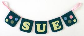 Naamslinger voor Sue