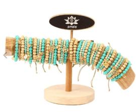 Witte/turq. armbandjes met goud