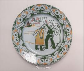 Art nouveau bord Franz Anton Mehlem, Bonn - De beste stuurlui staan aan wal