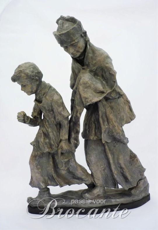 Grote groep in terracotta, de berechting - Camiel Bleusé