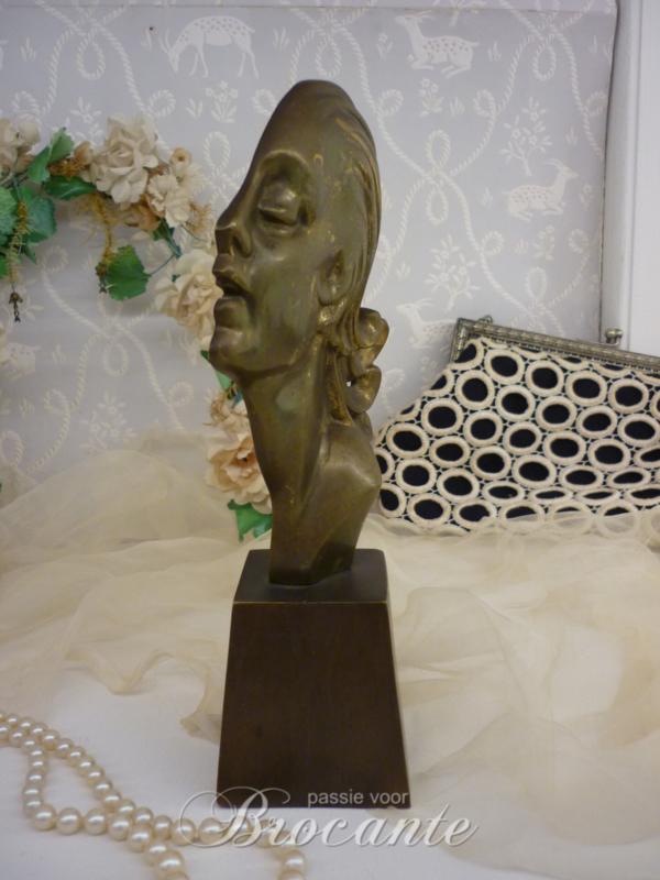 Art deco meisje hoofd in brons