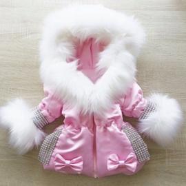 Luxe winterjas met grote bontkraag en glitter