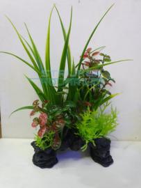 kunstplanten op zwart steen