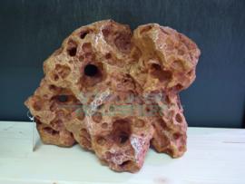 Decoratie kunst steen rood met gaten
