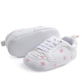 Witte sneakers met roze stiksel