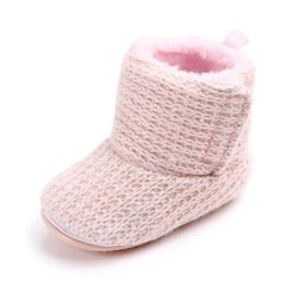 Roze gebreide laarzen