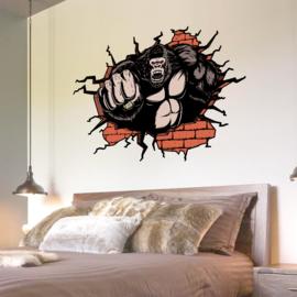 Muursticker Gorilla die door muur slaat 87 x 58cm