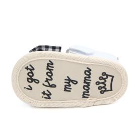 Witte sandalen met zwarte strik