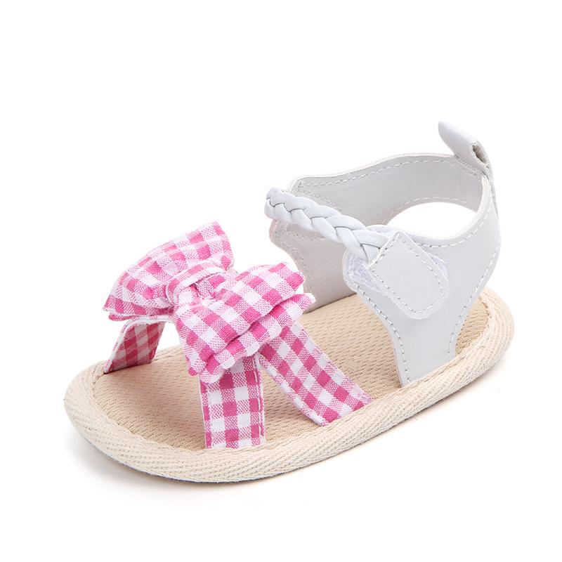 Witte sandalen met roze strik