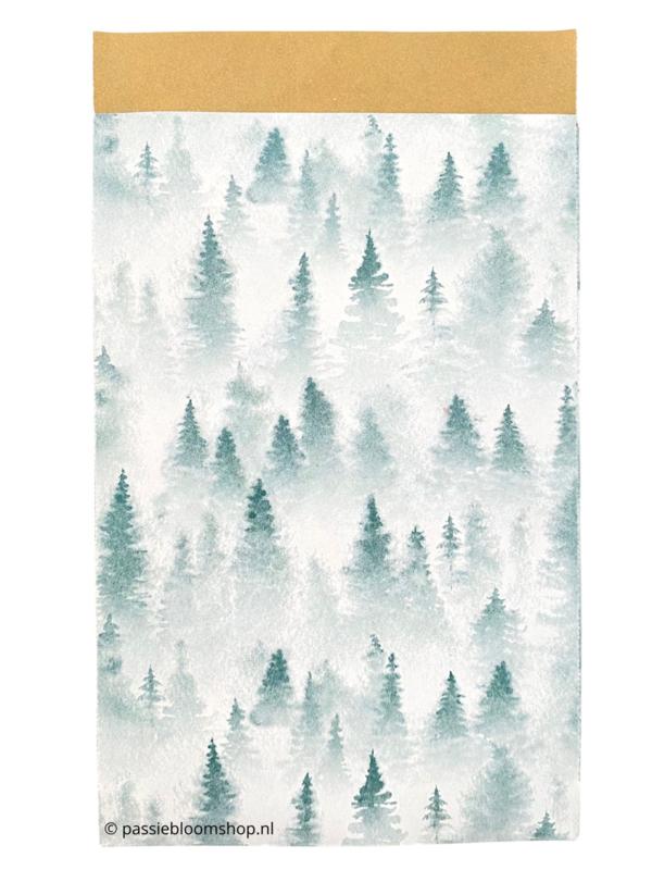 Cadeauzakjes kerst kerstbomen in de sneeuw