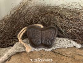 gietijzeren bakvormpje aan touw, vlinder