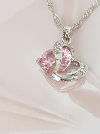 Hartvormige ketting met Paarse of Roze kristal steen