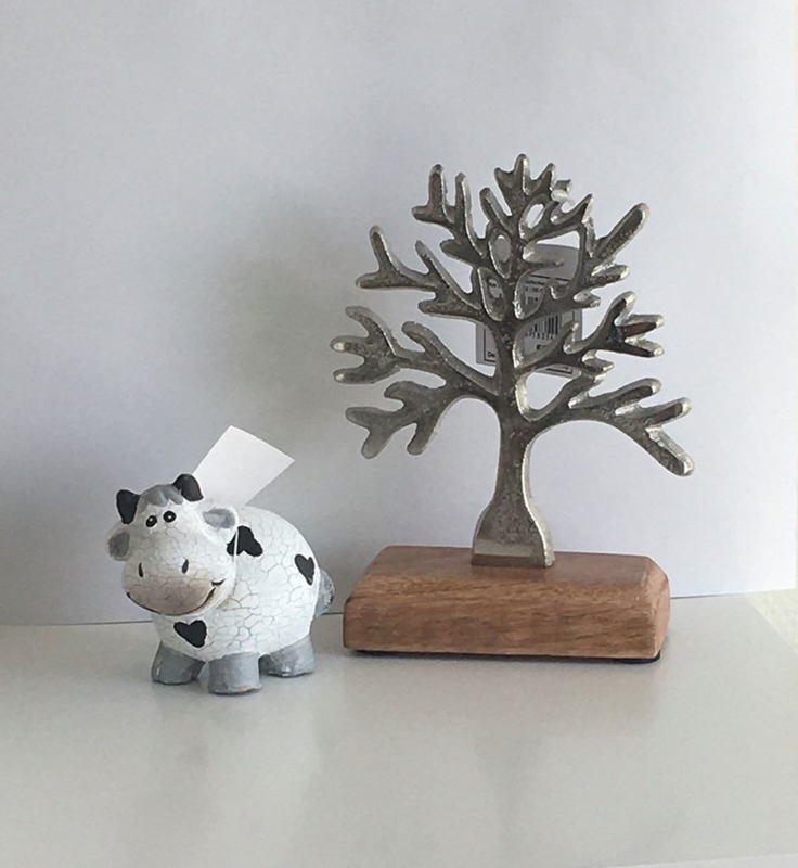 Zilveren boompje op hout