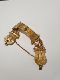 Zeldzaam mooi 18 kr gouden bijbelslot vermaakt tot armband