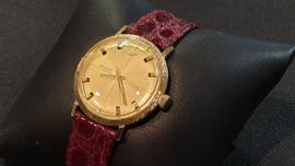 18 Kr gouden heren horloge met leren band  kast 33mm Enicar star jewels.