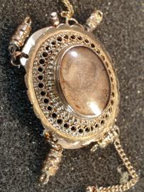 Antiek gouden sluiting steek sieraad  met haar ornament 2.5 bij 2 cm