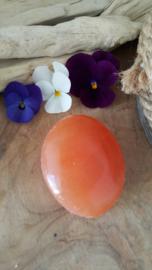 Oranje seleniet handsteen