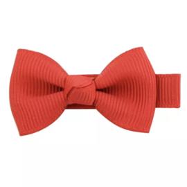 Haarlokspeld met strik rood 4 cm