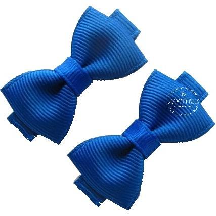 Haarlokspeld met strik koningsblauw 4 cm