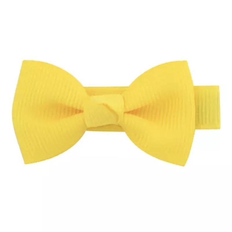 Haarlokspeld met strik geel 4 cm
