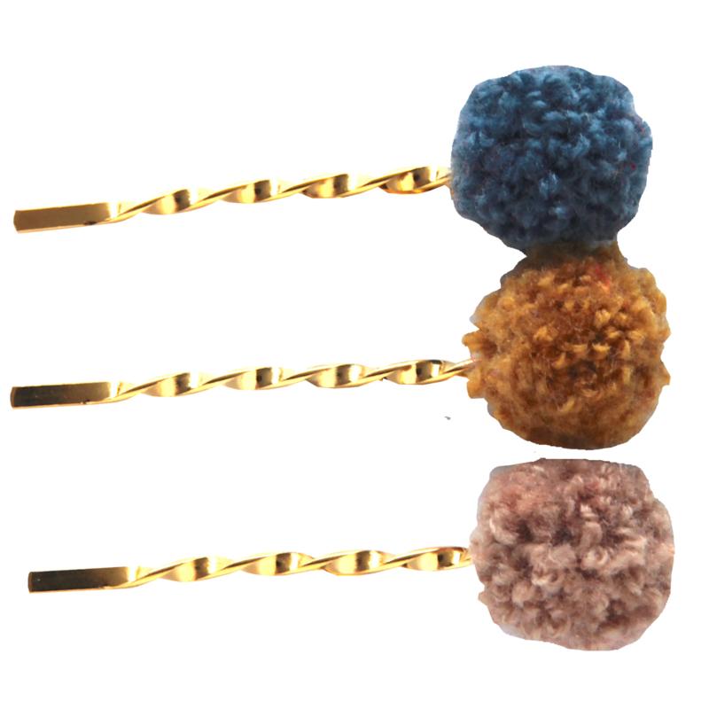 Haarschuifjes goudkleur met pompom oker bobby pin