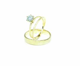 Trouwringen in 18kt geel goud, het damesmodel is een twistring met moissanite, voor dit paar 2350€