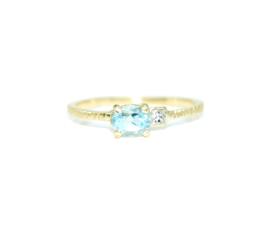 Verlovingsring in 18kt geel goud met blauwe topaas en princess cut diamant