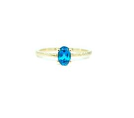 verlovingsring in 18kt geel goud met een london blue topaz