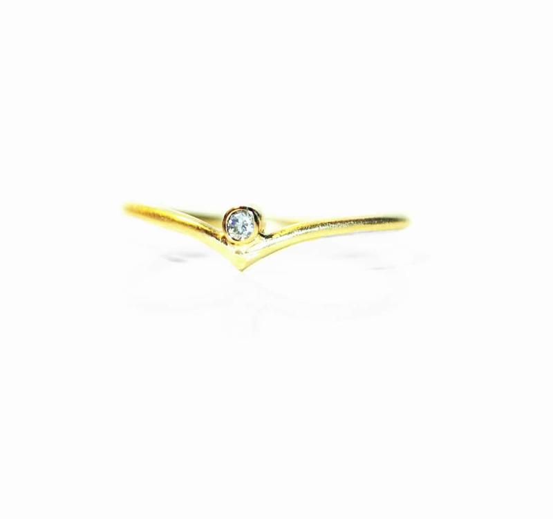 Verlovingsring in 18kt geel goud met een diamantje