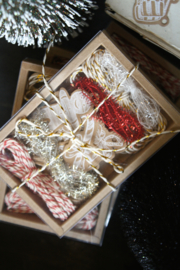 Gift box with Christmas/winter kraft paper tag mix with tinsel & twine.