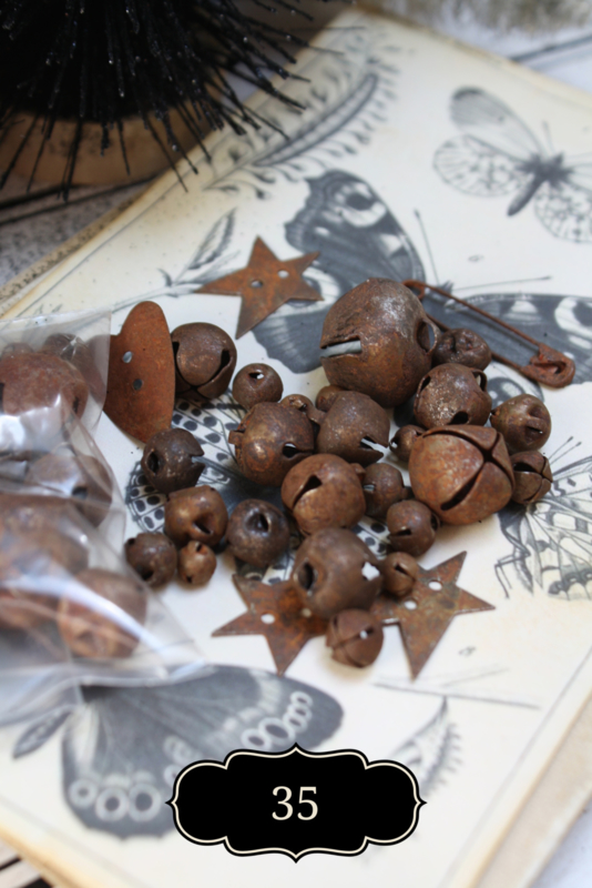 Set of rusty jingle bells and other rusty decoration.