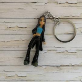 Sleutelhanger- Stoere dame  met zwarte lange jasje