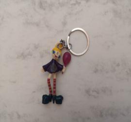 Grappige clown sleutelhanger in paars jurkje