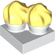 Duplo cupcakes met geel gedraaid ijs