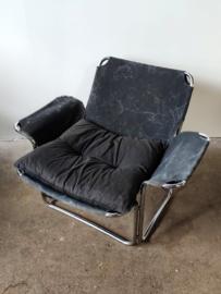 Vintage buisframe fauteuil met canvas zitting
