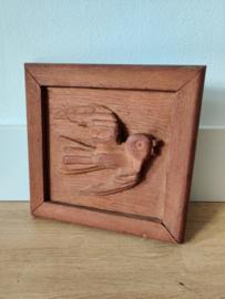 Vintage houtsnijwerk zwaluw