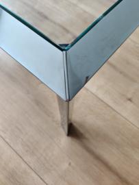 Grote design salontafel met glazen blad