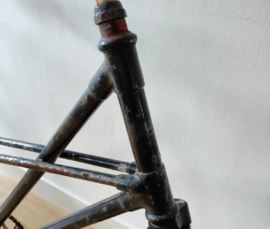 Oude tandam met kruis frame