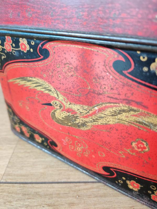 Vintage blik met kraan vogel opdruk