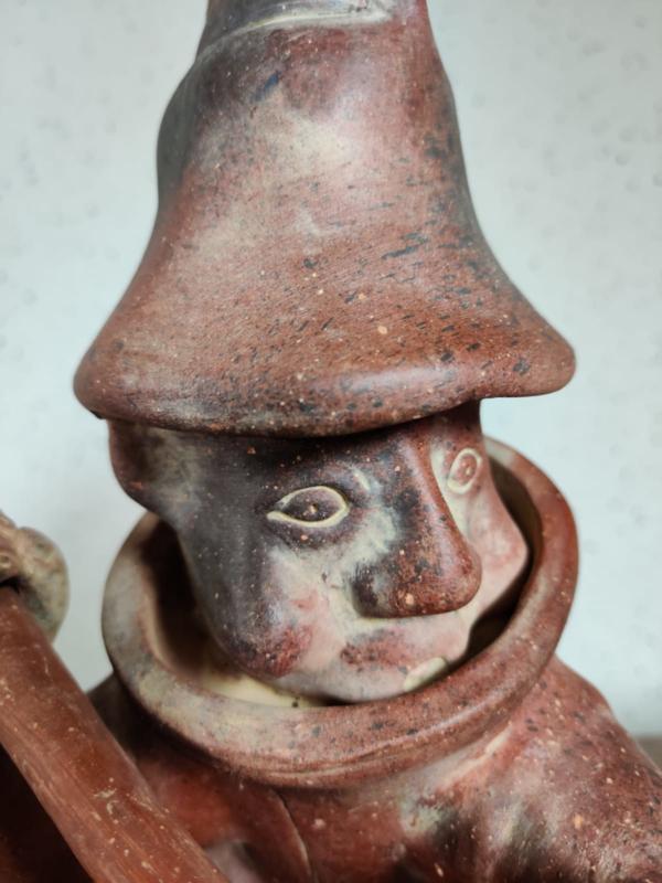Terracotta brandweerman beeld