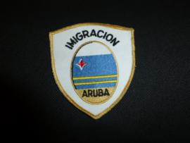 Mouwembleem Imigracion Aruba